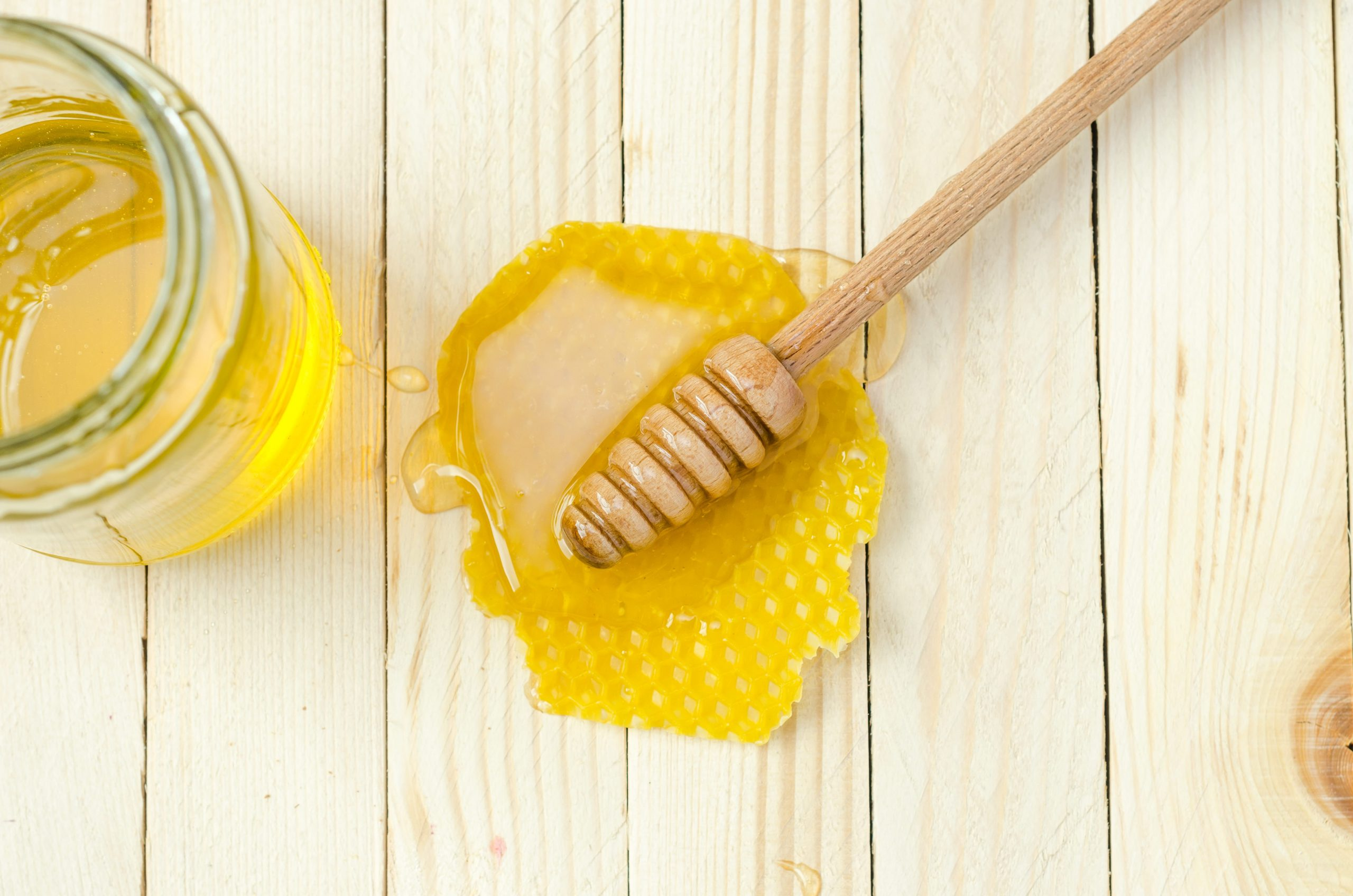 how much honey does one bee make